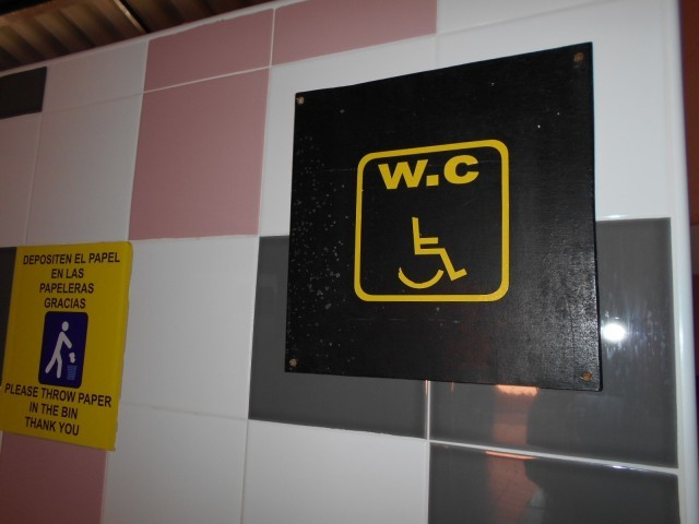 Photo/s of adapted toilet in common area - general information - stand-alone cubicle - signs