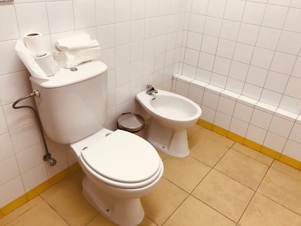 Photo/s of adapted toilet in common area - general information - stand-alone cubicle - characteristics - bathroom
